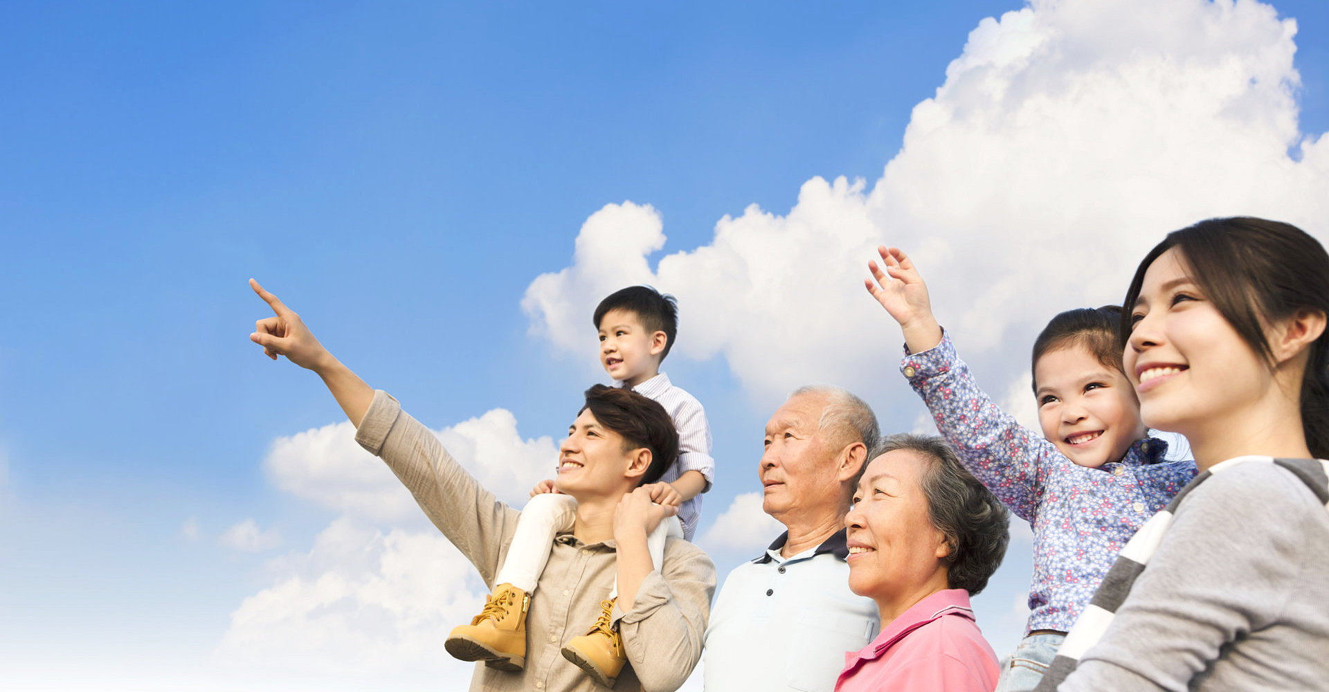 asian family looking at the sky